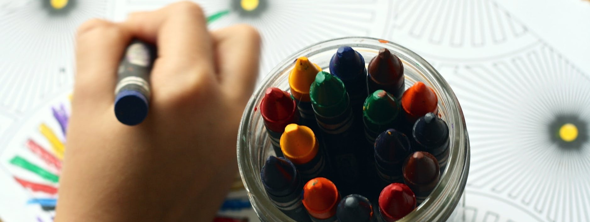 Using crayons to color a picture